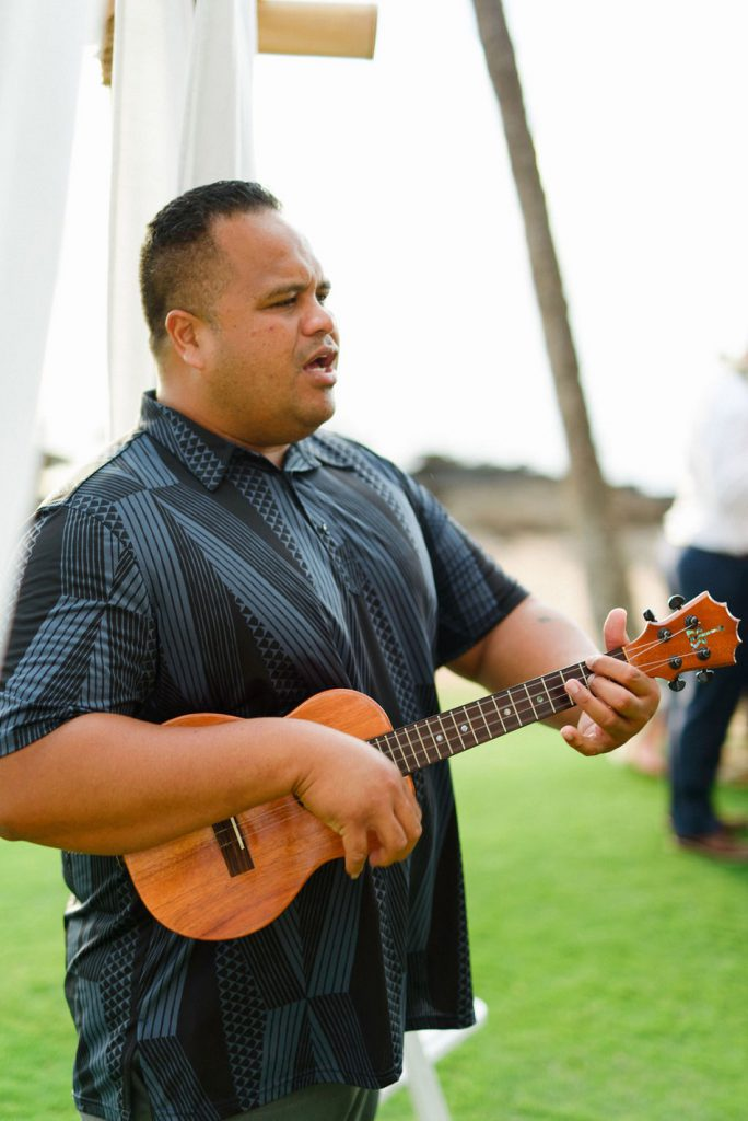 Marvin Tevaga singing live music for the wedding ceremony.